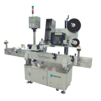 Labelling systems: inline trunnion series labeling system
