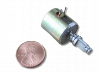 Miniature manual reset latching solenoid