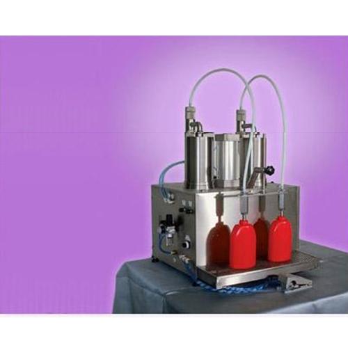 Semi - automatic table top volumetric piston filling machine