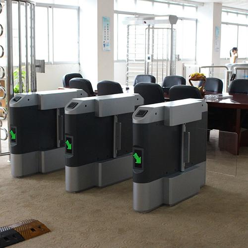 Optical barrier-type flow control turnstile